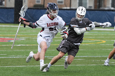 TIM JEAN/Staff photo  Central's Chase Dunn, left, looks to make a play with the ball during a boys lacrosse game against Westford Academy. Central lost 11-10.  4/20/19