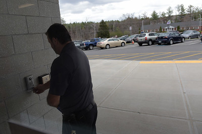 TIM JEAN/Staff photo  A visitor presses a button a video security intercom system before entering Salem High School. Schools across the country have inproved safety measures after the shootings at Columbine High School in Littleton, Colorado on April 20, 1999.    4/19/19