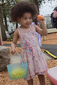 TIM JEAN/Staff photo  Ana Perez, 2, of Haverhill, shows her mother an egg she found during the Trinity Episcopal Church in Haverhill annual Easter Egg Hunt.  4/20/19