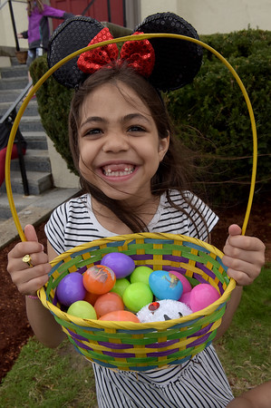 TIM JEAN/Staff photo  Bri Peralta, 6, of Haverhill, shows off her basket full of plastic eggs during the Trinity Episcopal Church in Haverhill annual Easter Egg Hunt.  4/20/19