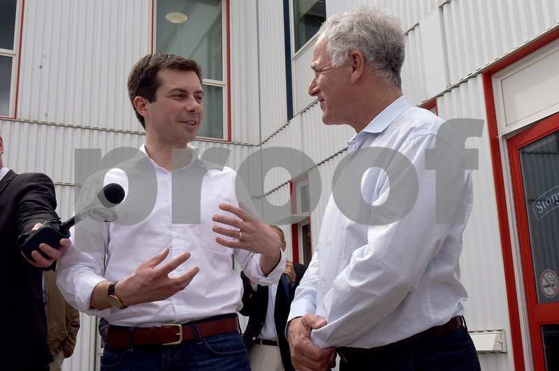 TIM JEAN/Staff photo  Democratic presidential candidate Pete Buttigieg, left, talks with Gary Hershburg, CEO of Stonyfield Yogurt during a campaign stop in Londonderry, NH.   4/19/19