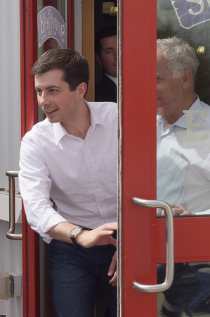 TIM JEAN/Staff photo  Democratic presidential candidate Pete Buttigieg, left, exits Stonyfield Yogurt with its CEO Gary Hershburg after speaking to workers during a campaign stop in Londonderry, NH.   4/19/19