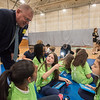 AMANDA SABGA/Staff photo<br /> <br /> Merrimack Valley YMCA President and CEO Gary Morelli chats with students during an event at the Robert Frost School in Lawrence.<br /> <br /> 4/25/18