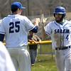 TIM JEAN/Staff photo<br />   <br /> At right, Salem's Matt Soldano high fives his teammates after scoring a run during a baseball game against Nashua South High School. Salem won 6-4.   4/24/18