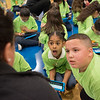 AMANDA SABGA/Staff photo<br /> <br /> Ronehily Guzman, 9 and Adrian Ventura, 9, react to conversation with a New Balance representative during an event at the Robert Frost School in Lawrence.<br /> <br /> 4/25/18