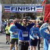 RYAN HUTTON/ Staff photo<br /> Colin Hessel, of North Andover, catches his breath as he cools down after crossing the finish line of the Run for the Troops 5K at Whittier Court in Andover on Sunday.