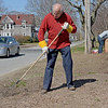 TIM JEAN/Staff photo<br />   <br /> David Shaw, of Haverhill, rakes up debris in the island along Lincoln Avenue during a Earth Day cleanup in Haverhill.     4/21/18