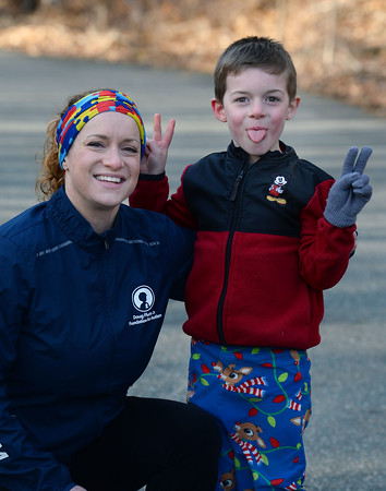 CARL RUSSO/Staff photo Lisa and her son Nathan, 6, have some fun with the photographer. She is wearing a colorful headband designed with puzzle pieces, the most iconic and recognizable symbol of autism.   <br /> <br /> Lisa Cordima of North Andover is running the Boston Marathon (now in September) for her son and the Doug Flutie Jr Foundation to battle Autism. 3/16/2020