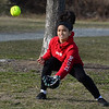 CARL RUSSO/Staff photo Future Haverhill high softball player, Elaine Perez, 13 of Haverhill plays  catch at Winnekenni Park on March 18.<br /> <br /> Haverhill people took advantage of a sunny and mild Wednesday afternoon to enjoy the day and forget about the coronavirus, for at least a little while<br /> <br /> With temperatures in the 50's, neighbors  walked the Winnekenni Park trail and played in the park. Across town others stopped to buy ice cream at Carter's Ice Cream stand in Bradford. 3/18/2020