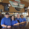 TIM JEAN/Staff photo<br /> <br /> Dominic's Diner owners Gebran and Vicky Khoury, their father Elie Khoury, and Tisha Jimenez pause for a quick photo at the lunch counter. The diner, at the Lawrence Municipal Airport in North Andover is having a fundraiser for Autism Awareness Month, with 100 percent of what they collect being donated to the Melmark School in Andover. Their son Dominic is a student at the Melmark School.  4/1/21