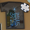 TIM JEAN/Staff photo<br /> <br /> This T-shirt being sold at Dominic's Diner is part of a fundraiser effort for Autism Awareness Month, with 100 percent of what is being collected donated to the Melmark School in Andover. The owners son Dominic is a student at the Melmark School.  4/1/21