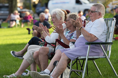 TIM JEAN/Staff photo  People applaud as they listen to the Katrina Marie Band perform during Andover's Concerts in the Park series. 8/22/19