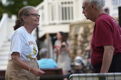 TIM JEAN/Staff photo  Gloria April, left, of Lowell and her brother Rodger April, dance as they listen to the Katrina Marie Band perform during Andover's Concerts in the Park series. 8/22/19