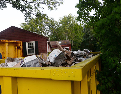 CARL RUSSO/Staff photo The clean up has begun to remove Hundreds of boxes with abandoned computers on the property of 45 Maclarnon Road in Salem NH. 8/24/2019