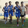 CARL RUSSO/staff photo. Salem's senior captain, Sean Holden, front, captured second place and Salem sophomore Jackson Mazejka, left, captured third place in the cross country meet against Alvirne and Timberlane at Timberlane high school. Salem junior, Massi Bosli, second from the left, stays close to his teammates. 9/4/2018
