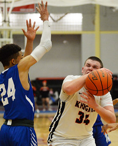 CARL RUSSO/Staff photo North Andover's Garrett Murphy fights for the loose ball against Methuen's Emmanuel Lopez under the hoop. The North Andover Knights defeated the Methuen Rangers 69-39 in boys basketball action. 12/14/2018