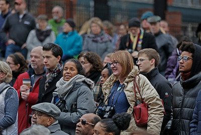 MIKE SPRINGER/Staff photo A large crowd gathers Sunday at 86 Washington Street in downtown Haverhill to see the unveiling of a new mural depicting the city's immigrant heritage. 12/16/2018
