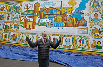 MIKE SPRINGER/Staff photo Haverhill City Councilor Tom Sullivan speaks during an unveiling ceremony Sunday for Alexander Golob's mural at the Garibaldi Club depicting Haverhill's immigrant heritage. 12/16/2018