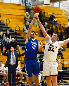 CARL RUSSO/Staff photo North Andover's Garrett Murphy defends as Methuen's Luis Tejeda makes the lay up. The North Andover Knights defeated the Methuen Rangers 69-39 in boys basketball action. 12/14/2018