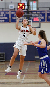 MIKE SPRINGER/Staff photo North Andover's Emma Liporto goes up for a shot Sunday against Bedford at Tewksbury Memorial High School. 12/16/2018