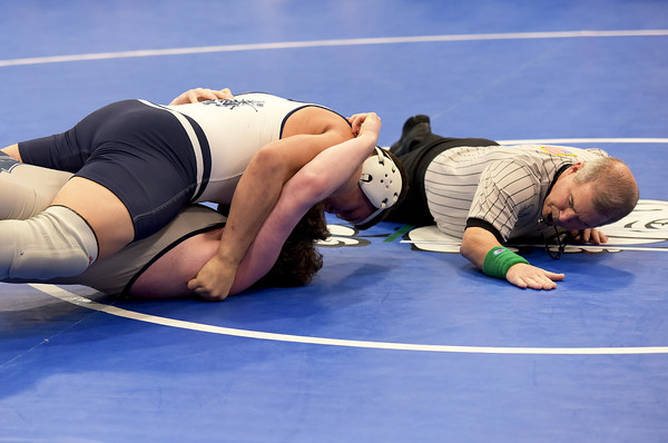 TIM JEAN/Staff photo  Lawrence's Brandon Santell, top, pins St. John's Prep Jack Sullivan in the 220 pound match during a quard wrestling meet at Salem High School.   12/15/18