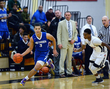 CARL RUSSO/Staff photo Methuen's Onyera Chibogwu races to the hoop as North Andover's Darren Watson give chase.The North Andover Knights defeated the Methuen Rangers 69-39 in boys basketball action. 12/14/2018