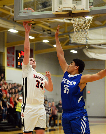 CARL RUSSO/Staff photo North Andover's Garrett Murphy makes the lay up as Methuen's Darwin Oleaga defends The North Andover Knights defeated the Methuen Rangers 69-39 in boys basketball action. 12/14/2018