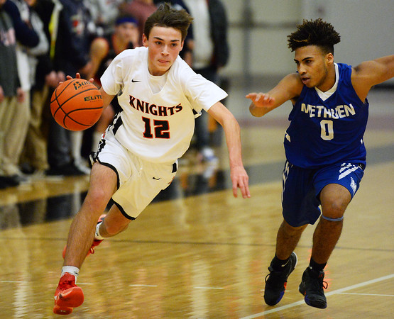 CARL RUSSO/Staff photo North Andover's Mikey Gorgoni races to the hoop as Methuen's Wildy Santana chases him down. The North Andover Knights defeated the Methuen Rangers 69-39 in boys basketball action. 12/14/2018