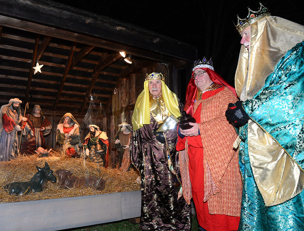 CARL RUSSO/Staff photo.  Members of Salem's Knights of Columbus, Council 4442, from left, Ken Akerley, Dave Thompson and Chanel Simard dressed as the three wise men and  walk over to the nativity scene as part of the ceremony.   The 65th annual Christmas tree lighting and nativity scene ceremony, hosted by Salem Lions Club, was held Wednesday night at Salem's Veterans' Park. After the ceremony, Mrs. Claus greeted the children while they enjoyed cookies and hot cocoa. Santa was sick in bed with a bad cold. 11/28/2018