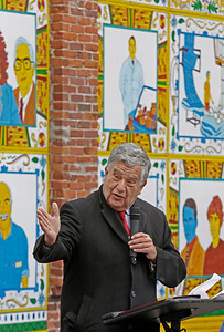 MIKE SPRINGER/Staff photo Haverhill Mayor James J. Fiorentini speaks during an unveiling of Alexander Golob's mural depticting Haverhill's immigrant heritage on Sunday at 86 Washington Street in downtown Haverhill. Fiorentini's grandfather, Italian immigrant Gus Fiorentini, is depected on one of the panels in the background, directly above the Mayor. 12/16/2018