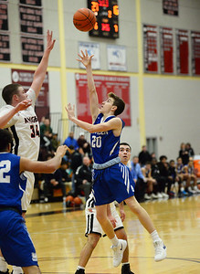 CARL RUSSO/Staff photo Methuen's Mitchell Crowe takes the short jump shot. The North Andover Knights defeated the Methuen Rangers 69-39 in boys basketball action. 12/14/2018
