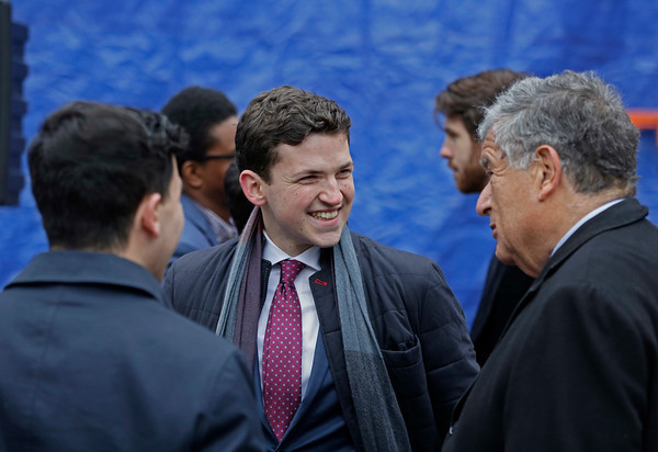 MIKE SPRINGER/Staff photo Artist Alexander Golob, center, of Wellesley visits with Haverhill Mayor James J. Fiorentini, right, and state Rep. Andy Vargas before the unveiling of Golob's mural depticting Haverhill's immigrant heritage on Sunday at 86 Washington Street in downtown Haverhill. 12/16/2018