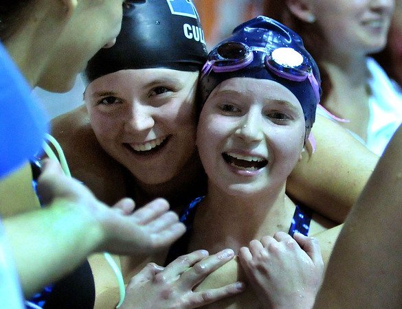 """She was 4-foot-11, tops, and her times were middling at best.<br /> But if you were to write a book about amazing Methuen athletes, Allison """"Allie"""" Hawkes deserves a chapter alongside the likes of Olympic gold medalist Fred Tootell and Cy Young Award winner Steve Bedrosian.<br /> <br /> Fellow Ranger swimming captain Abby Tremblay said of her close friend's 20-year battle with cancer, """"She took it like a champ."""" And that may be the best way to describe Hawkes. She was a champion. The champ died on Dec. 6, a few weeks shy of her 27th birthday. <br /> <br /> Allie Hawkes is remembered in this photo and words from 2010. As Methuen's head coach, Jason Smith extends his hand out to congratulate junior Allie Hawkes, right, her teammate Samantha Cullum gives her a big hug after finishing the 500 freestyle race. Hawkes, a cancer survivor in 2010 competed in the 500 freestyle race for the first time as a MHS Ranger. 10/26/2010."""