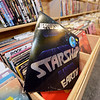"""RYAN HUTTON/ Staff photo<br /> A copy of Jefferson Starship's """"Earth"""" sits in the vinyl records aisle at Comically Speaking in Reading."""