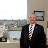 RYAN HUTTON/ Staff photo<br /> Pentucket Bank CEO Scott Cote in his office overlooking the Merrimack River in the bank's new offices on the fourth floor of Harbor Place.