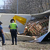 TIM JEAN/Staff photo<br />   <br /> State police investigate the scene where a tractor-trailer rolled over on the ramp from Interstate 495 North to Interstate 93 South. The truck spilled fuel as well as watermelons onto the highway.  4/28/18