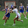 TIM JEAN/Staff photo<br /> <br /> Londonderry's Sammy LeClair, left, carries the ball out as Pinkerton's Kiley Davis tries to stop her during a girls lacrosse game in Derry.   4/27/18