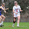 TIM JEAN/Staff photo<br /> <br /> Londonderry's Vic Kelly, left, defends against Pinkerton's Hailey Peredna during a girls lacrosse game in Derry.   4/27/18