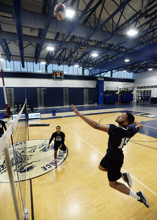 CARL RUSSO/Staff photo. Lawrence's Andre Wilson spikes the ball. Lawrence defeated North Andover in three straight games in volleyball action. 4/25/2018
