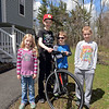 RYAN HUTTON/ Staff photo<br /> Liam Mullaly, 12, center left, stands with his bike and his siblings, Connor, 10, center right, Keeley, 7, left, and Declan, 8, right, outside their Windham home. Liam is participating in a fundraising bike ride for Connor, who is battling Duchenne muscular dystrophy.