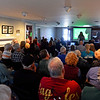 RYAN HUTTON/ Staff photo<br /> Lauren Kosky-Stamm, director of programs for the Andover Historical Society, speaks to a crowd at the Society building on Main Street on Sunday before the start of a presentation on how South Lawrence was once a part of Andover.