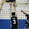 CARL RUSSO/staff photo. Andover's captain, Yanchen Zhan spikes the ball as Haverhill's Patrick Gosselin, left, and Cooper Gibbs reach up to block. Andover against Haverhill in volleyball action Monday afternoon. 4/30/2018