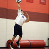 CARL RUSSO/Staff photo. Lawrence's Carlos Martinez  serves the ball. Lawrence high defeated Pinkerton Academy in boys volleyball action Saturday afternoon. 4/28/2018