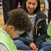 AMANDA SABGA/Staff photo<br /> <br /> New Balance Community Outreach Coordinator Michelle Wong looks on as students at the Robert Frost School in Lawrence partake in various exercises.<br /> <br /> 4/25/17