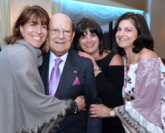 CARL RUSSO/staff photo. STEPPING OUT: The Professional Center for Child Development held their  annual Passport to Possibilities Gala and silent auction on April 27. The Community Service Award recipient, Enzo Fossella of Andover of the Andover Service Club is congratulated by his daughters. From left, Lisa Fossella of Wilmington, Joanne Heim of Atkinson and Terri Pecorelli of Andover.  4/27/2018