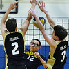 CARL RUSSO/staff photo. Andover's captain, Yanchen Zhan spikes the ball as Haverhill's AJ Tamburino, left, and Cooper Gibbs defend. Andover against Haverhill in volleyball action Monday afternoon. 4/30/2018
