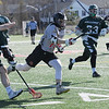 TIM JEAN/Staff photo<br />   <br /> North Andover's Mark Federico, center, sprints with the ball through the defense during a boys lacrosse game against Billerica. North Andover won 11-7.    4/26/18