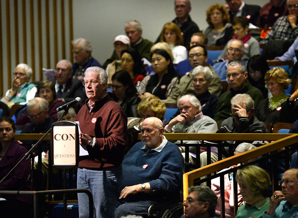 CARL RUSSO/Staff photo. Bob Pokress talks about Article 4 at Andover's annual town meeting Monday night at the Collins Center. 4/30/2018