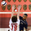 CARL RUSSO/Staff photo. Lawrence's Andre Wilson spikes the ball over the net and Pinkerton's Andy Bolduc. Lawrence high defeated Pinkerton Academy in boys volleyball action Saturday afternoon. 4/28/2018