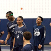 CARL RUSSO/Staff photo. Lawrence players celebrate. Lawrence defeated North Andover in three straight games in volleyball action. 4/25/2018